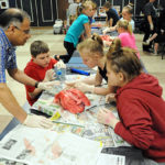 Fifth graders learn about respiratory health with pig lungs